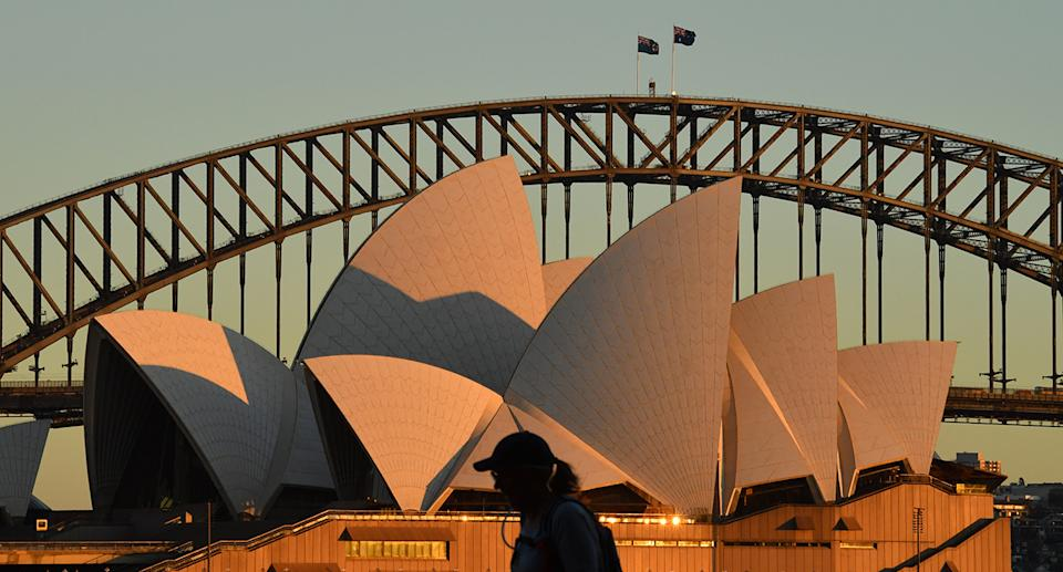 A person with the Sydney Opera House in the background. Source: AAP Image
