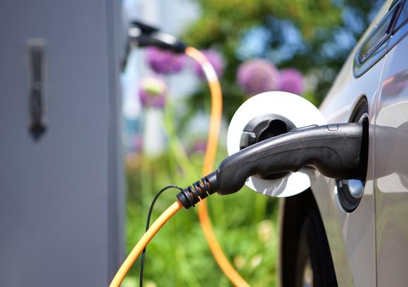 A hybrid electric car charging its battery.