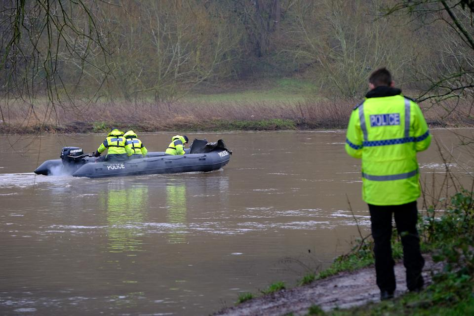 Specialist police underwater search teams on the river Trent. (SWNS)