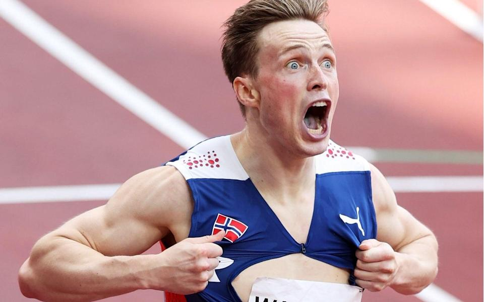Karsten Warholm of Team Norway reacts after winning the gold medal in the Men's 400m Hurdles Final on day eleven of the Tokyo 2020 Olympic Games at Olympic Stadium on August 03, 2021 in Tokyo, - GETTY IMAGES