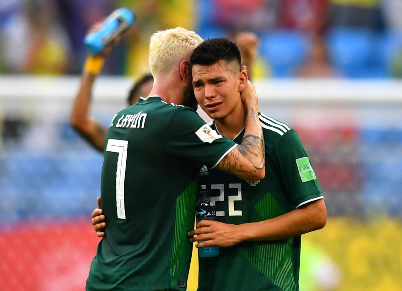 <p>Mexico's Hirving Lozano and Miguel Layun look dejected after the match REUTERS/Dylan Martinez </p>