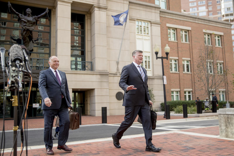 Members of the defense team for Paul Manafort, Kevin Downing, right, and Thomas Zehnle, left, depart the federal court following a hearing in the criminal case against former Trump campaign chairman Paul Manafort in Alexandria, Va., Friday, Oct. 19, 2018. (AP Photo/Andrew Harnik)