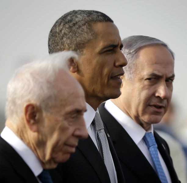 President Barack Obama walks on the tarmac with Israeli Prime Minister Benjamin Netanyahu, right, and Israeli President Shimon Peres, left, prior to his departure from Ben Gurion International Airport in Tel Aviv, Israel, Friday, March 22, 2013, (AP Photo/Pablo Martinez Monsivais)