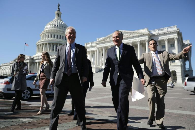 Democratic Senators Chris Van Hollen (3rd L) and Charles Schumer (2nd R) head for a news conference with people who may be negatively affected by the Republicans' attempt to repeal and replace Obamacare, outside the U.S. Capitol March 9, 2017