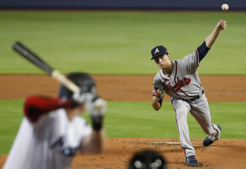 Atlanta Braves' Max Fried pitches to Miami Marlins' Garrett Cooper during the first inning of a baseball game, Sunday, June 9, 2019, in Miami. (AP Photo/Wilfredo Lee)