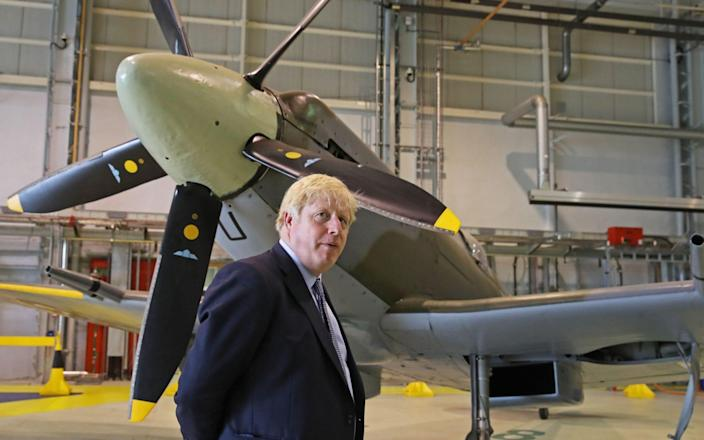 Boris Johnson visiting RAF Lossiemouth in Moray in July this year - AFP