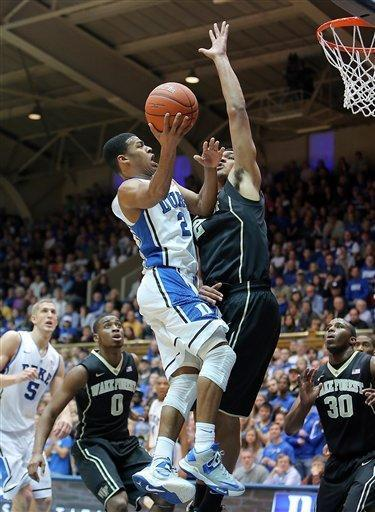 Duke's Quinn Cook (2) drives on Wake Forest's Devin Thomas during the first half of an NCAA college basketball game in Durham, N.C., Saturday, Jan. 5, 2013. (AP Photo/Ted Richardson)