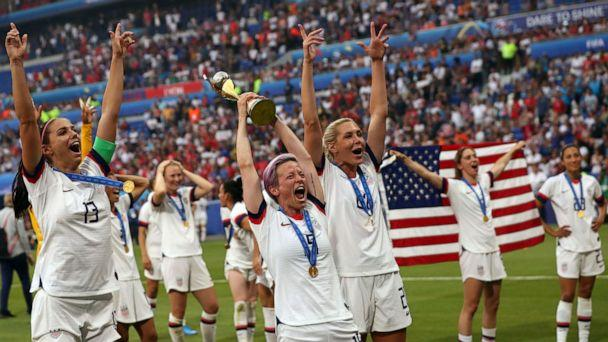 PHOTO: In this July 7, 2019, file photo, Megan Rapinoe holds the trophy celebrating at the end of the Women's World Cup final soccer match between US and The Netherlands at the Stade de Lyon in Decines, outside Lyon, France. (Francisco Seco/AP, FILE)
