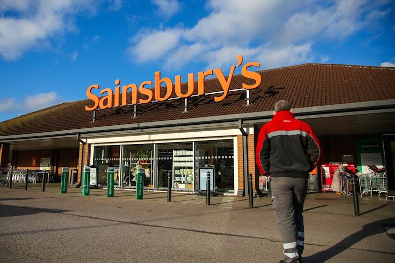 A shopper arrives to shop at Sainsbury's supermarket in north London