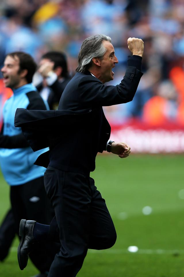 MANCHESTER, ENGLAND - MAY 13: Roberto Mancini the manager of Manchester City celebrates winning the title as the final whistle blows during the Barclays Premier League match between Manchester City and Queens Park Rangers at the Etihad Stadium on May 13, 2012 in Manchester, England. (Photo by Alex Livesey/Getty Images)