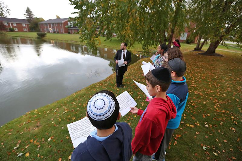 Hasten Hebrew Academy of Indianapolis fifth-graders participate in a Tashlich ceremony, Friday, October 3, 2014, a symbolic casting away of sins. The ritual is traditionally performed during Rosh Hashanah.