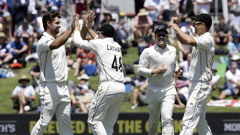 Colin de Grandhomme (l) has claimed two wickets on day one of the New Zealand-England Test