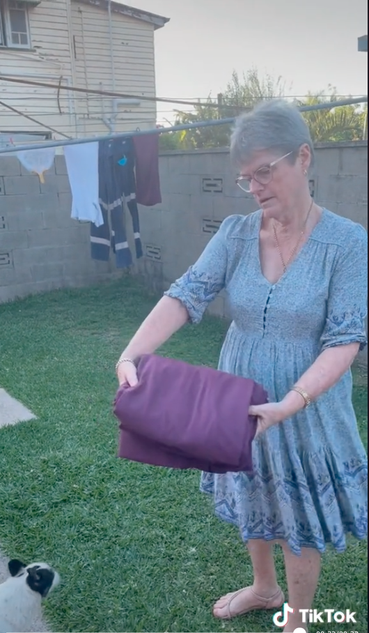 Woman with a folded fitted sheet