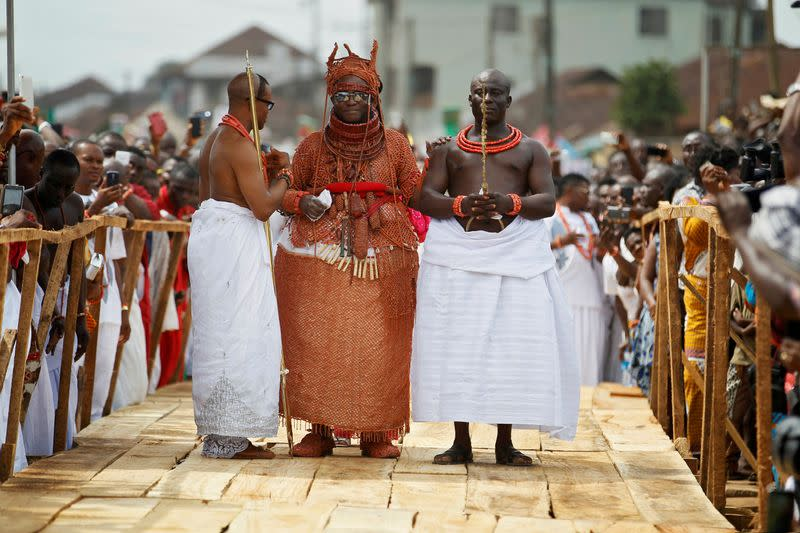 FILE PHOTO: Newly crowned Oba of Benin Kingdom Eheneden Erediauwa is guided through a symbolic bridge by the palace chiefs during his coronation in Benin city