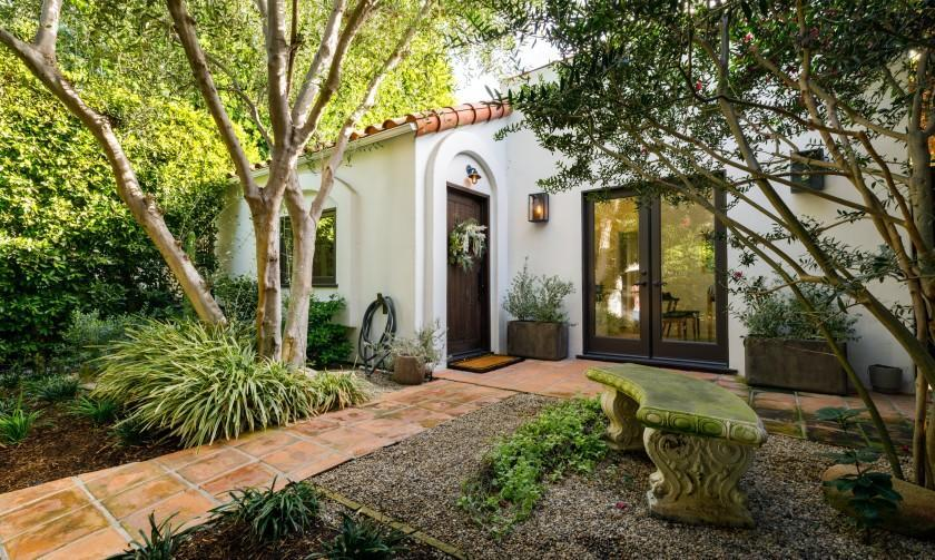 Built in the 1920s, the single-story bungalow expands to a leafy backyard with olive and lemon trees.