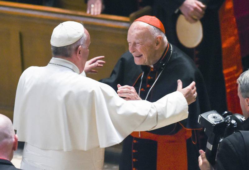 FILE - In this Sept. 23, 2015 file photo, Pope Francis reaches out to hug Cardinal Archbishop emeritus Theodore McCarrick after the Midday Prayer of the Divine with more than 300 U.S. Bishops at the Cathedral of St. Matthew the Apostle in Washington. Allegations that the most respected U.S. cardinal repeatedly sexually abused both boys and adult seminarians has raised questions about who in the Catholic Church hierarchy knew, and what Pope Francis is going to do about it. If the accusations against Cardinal Theodore McCarrick bear out, will Francis revoke his title of cardinal, sanction him to a lifetime of prayer or even defrock him, the expected sanction if McCarrick were a mere priest? (Jonathan Newton/The Washington Post via AP, Pool, File)