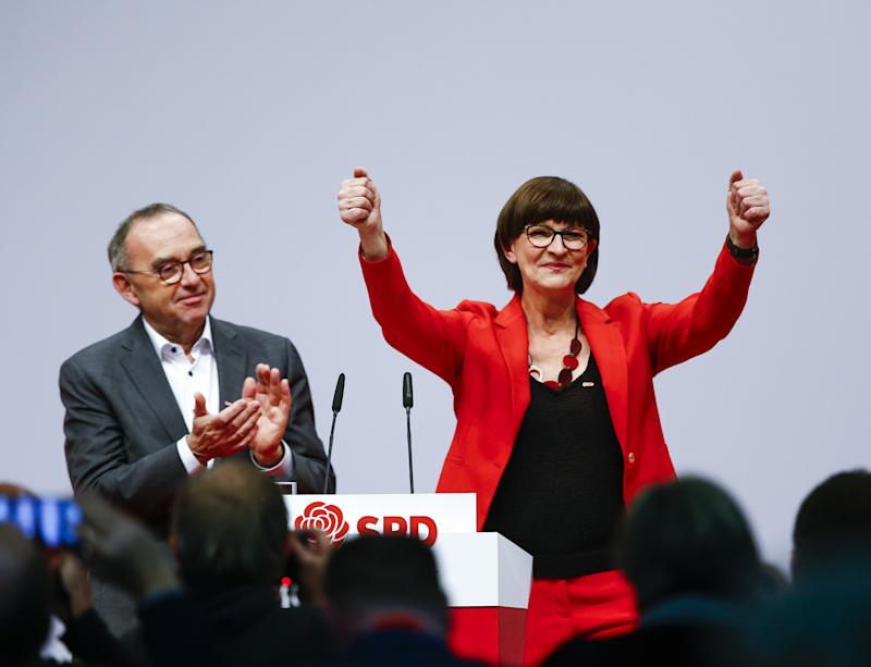 BERLIN, GERMANY - DECEMBER 06: Designated Social Democratic Party (SPD) co-chairs Saskia Esken (R) and Norbert Walter-Borjans (L) are seen after winning co-presidency during the SPD Party Convention at CityCube in Berlin, Germany on December 06, 2019. SPD party members will gather in the German capital from 06 to 08 December to vote for the new party leadership. (Photo by Abdulhamid Hosbas/Anadolu Agency via Getty Images)