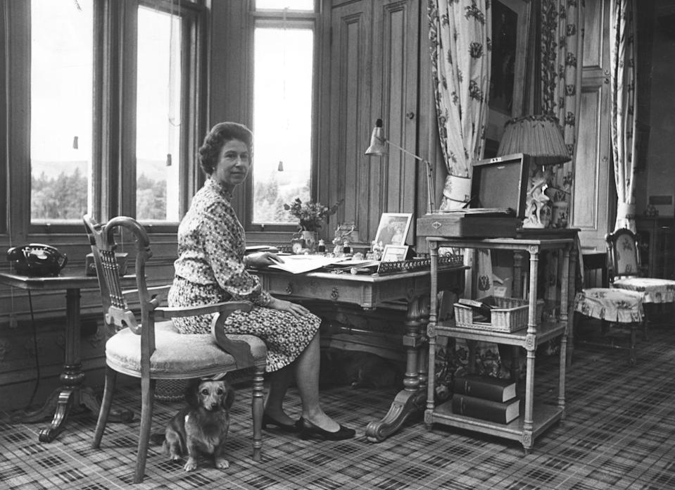 31st October 1972:  Queen Elizabeth II sitting in her study at Balmoral Castle, Scotland, dealing with despatch boxes containing State Papers sent from Whitehall.  (Photo by Fox Photos/Getty Images)