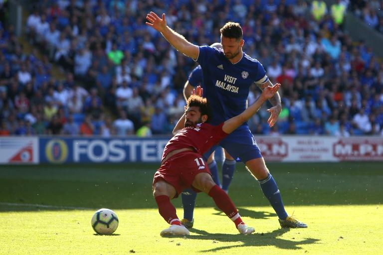 Liverpool's Egyptian forward Salah is fouled by Cardiff defender Morrison