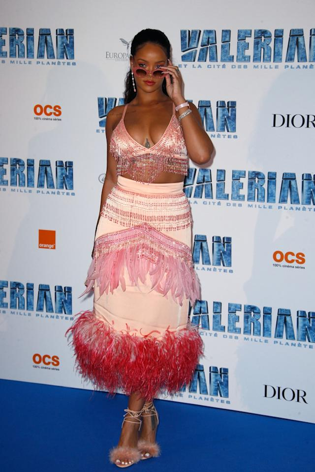 <p>Rihanna ditched the gowns for a fun Prada number full of beading and feathers. She teamed the pink ensemble with fluffy heels from Charlotte Olympia and matching sunglasses.<br /><i>[Photo: Getty]</i> </p>