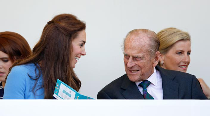 LONDON, UNITED KINGDOM - JUNE 12: (EMBARGOED FOR PUBLICATION IN UK NEWSPAPERS UNTIL 48 HOURS AFTER CREATE DATE AND TIME) Catherine, Duchess of Cambridge and Prince Philip, Duke of Edinburgh watch a carnival parade as they attend 'The Patron's Lunch' celebrations to mark Queen Elizabeth II's 90th birthday on The Mall on June 12, 2016 in London, England. (Photo by Max Mumby/Indigo/Getty Images)