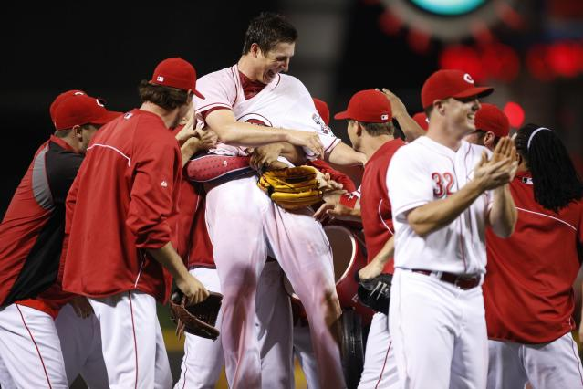 CINCINNATI, OH - JULY 2: Homer Bailey #34 of the Cincinnati Reds celebrates with teammates after throwing a no-hitter against the San Francisco Giants at Great American Ball Park on July 2, 2013 in Cincinnati, Ohio. The Reds won 3-0. (Photo by Joe Robbins/Getty Images)
