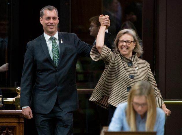 Green Party Leader Elizabeth May enters the House of Commons with the newly sworn in MP Paul Manly before question period on May 27, 2019.