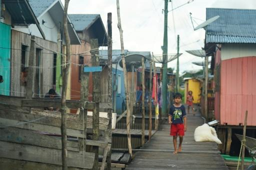 A boy walks through the town of Carauari, where residents fear the reach and spread of the coronavirus COVID-19 pandemic in the Amazon, Brazil on March 16, 2020