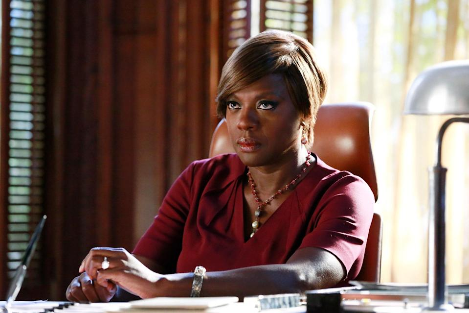 """In 2014, Davis finally got the chance to sink her teeth into a role befitting the expansiveness of her talents when she made the leap to television, starring as lawyer Annalise Keating in <strong>Shonda Rhimes</strong>'s soapy prime-time series <em>How to Get Away With Murder.</em> The messiness, moral ambiguity, and pronounced sexuality of Annalise Keating was somewhat of a departure from the mother roles that had marked Davis's career, and <a href=""""https://www.vanityfair.com/hollywood/2020/07/cover-story-viola-davis?mbid=synd_yahoo_rss&utm_social-type=owned&utm_medium=social&utm_source=twitter&utm_brand=vf"""" rel=""""nofollow noopener"""" target=""""_blank"""" data-ylk=""""slk:what drew her to"""" class=""""link rapid-noclick-resp"""">what drew her to</a> a part that would <a href=""""https://www.youtube.com/watch?v=OSpQfvd_zkE"""" rel=""""nofollow noopener"""" target=""""_blank"""" data-ylk=""""slk:win her the Emmy"""" class=""""link rapid-noclick-resp"""">win her the Emmy</a> for best actress in a drama series—making her <a href=""""https://www.vanityfair.com/hollywood/2015/09/viola-davis-emmy?mbid=synd_yahoo_rss"""" rel=""""nofollow noopener"""" target=""""_blank"""" data-ylk=""""slk:the first Black woman in television history"""" class=""""link rapid-noclick-resp"""">the first Black woman in television history</a> to do so. Davis's decision to join Shondaland proved to be a gift to us all, giving the world immensely quotable lines (""""Why is your penis on a dead girl's phone?""""), <a href=""""https://giphy.com/gifs/why-rachel-dolezal-chick-kZD8cN1MycfKw"""" rel=""""nofollow noopener"""" target=""""_blank"""" data-ylk=""""slk:iconic memes"""" class=""""link rapid-noclick-resp"""">iconic memes</a>, and a chance to see Davis in a whole new light. And with six seasons to fully explore the complicated Ms. Keating, Davis showed that she has the chops to keep us coming back for more."""