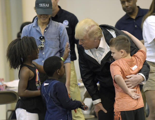 <p>President Donald Trump and Melania Trump meet people impacted by Hurricane Harvey during a visit to the NRG Center in Houston, Saturday, Sept. 2, 2017. (Photo: Susan Walsh/AP) </p>