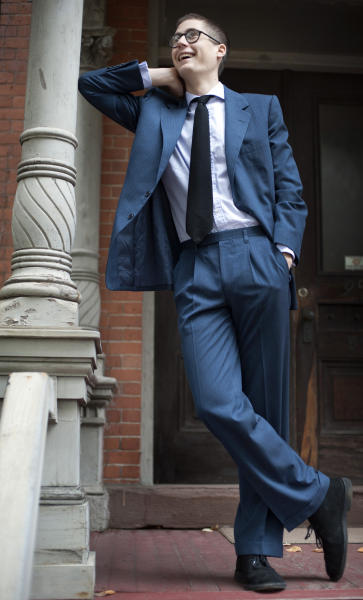 Peter Gamlen poses in a suit he found in the basement of his apartment in New Haven, Conn., Tuesday, Oct. 9, 2012. Gamlen believes the suit, that bears a tag with the name Paul Newman in it, may have belonged to actor. (AP Photo/Jessica Hill)