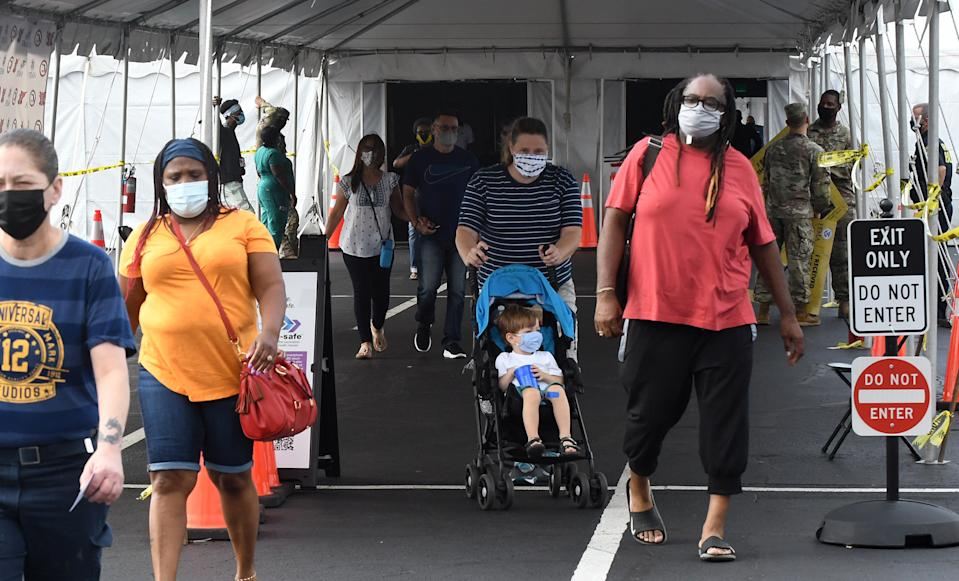 People leave the FEMA-supported COVID-19 vaccination site at Valencia State College in Orlando, Fla. (Paul Hennessy/SOPA Images/LightRocket via Getty Images)