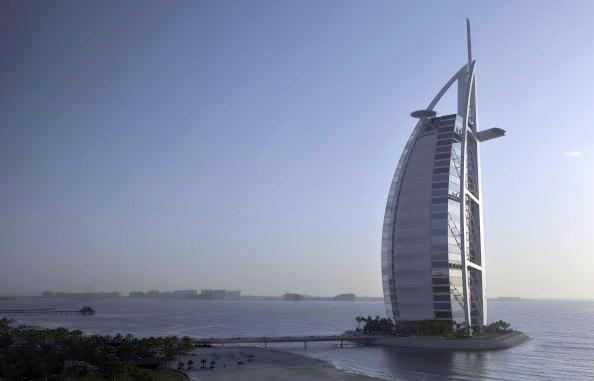 The luxurious Burj al Arab is the world's first seven-star hotel in Dubai. Photograph: Oliver Lang/AFP/Getty Images