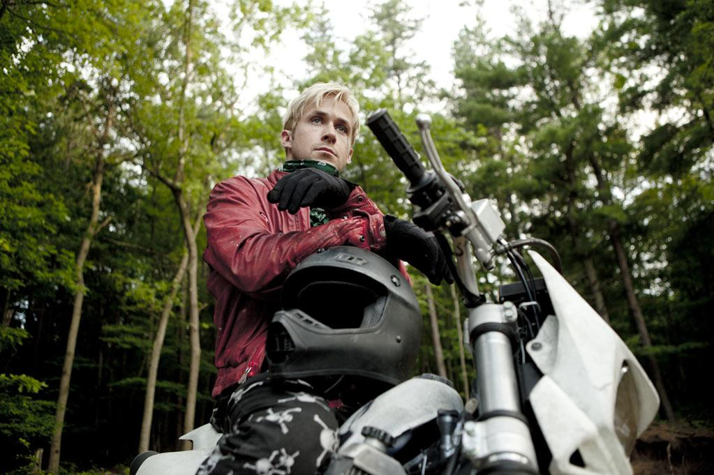 """""""The Place Beyond the Pines"""" Luke (Ryan Gosling) is a professional motorcycle rider who turns to bank robberies to support his newborn son. But when he crosses paths with a rookie police officer (Bradley Cooper), their violent confrontation spirals into a tense generational feud. The Place Beyond the Pines is a rich dramatic thriller, tracing the intersecting lives of fathers and sons, cops and robbers, heroes and villains. Also starring Rose Byrne, Ray Liotta and Eva Mendes."""