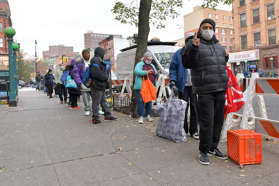 NEW YORK, NEW YORK - NOVEMBER 25: A view of the line as Food Bank For New York City distributes Thanksgiving meals to go at Food Bank Community Kitchen on November 25, 2020 in New York City. (Photo by Michael Loccisano/Getty Images for Food Bank For New York City)