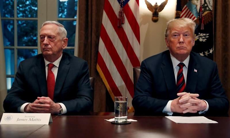 Trump speaks to the media while James Mattis minds his own business, in the cabinet room at the White House.