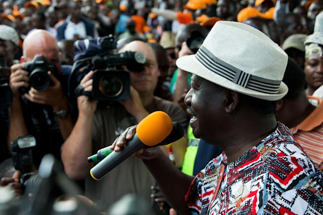 <p>National Super Alliance (NASA) presidential candidate, Raila Odinga, addresses a crowd at Uhuru Park in Nairobi's central business district, Kenya, Oct. 25, 2017. (Photo: Dai Kurokawa/EPA-EFE/REX/Shutterstock) </p>