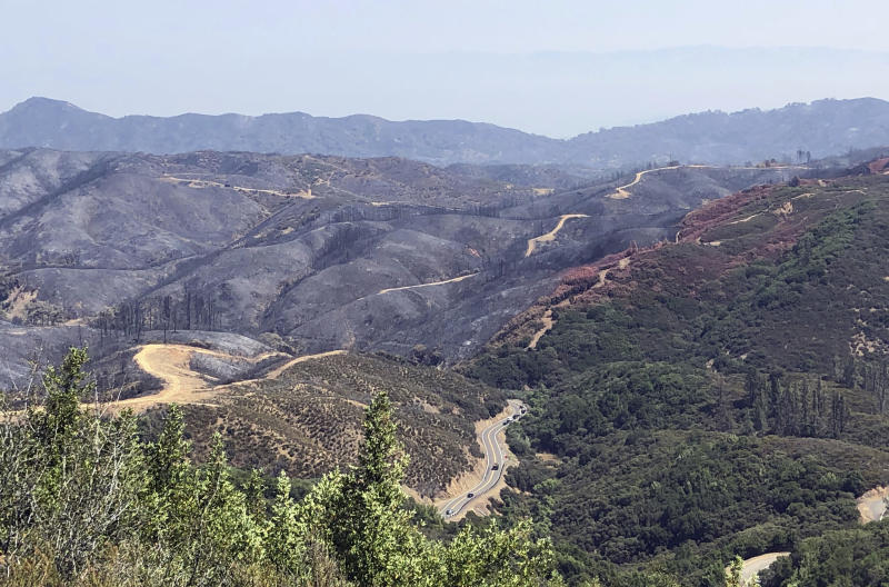 This photo taken Friday, Aug. 10, 2018 near Lakeport, Calif. shows dirt paths created by bulldozers in an effort to contain part of the largest wildfire on record in California. Firefighters are battling the largest wildfire on record in California, while foresters and other experts are working to repair the damage. Crews are smoothing out dirt roads and replacing fences to mitigate the damage caused not by flames but by the firefighters racing to extinguish them. They seek to restore private lands, protect the environment and water supply, and prevent erosion.(AP Photo/Jonathan J. Cooper)