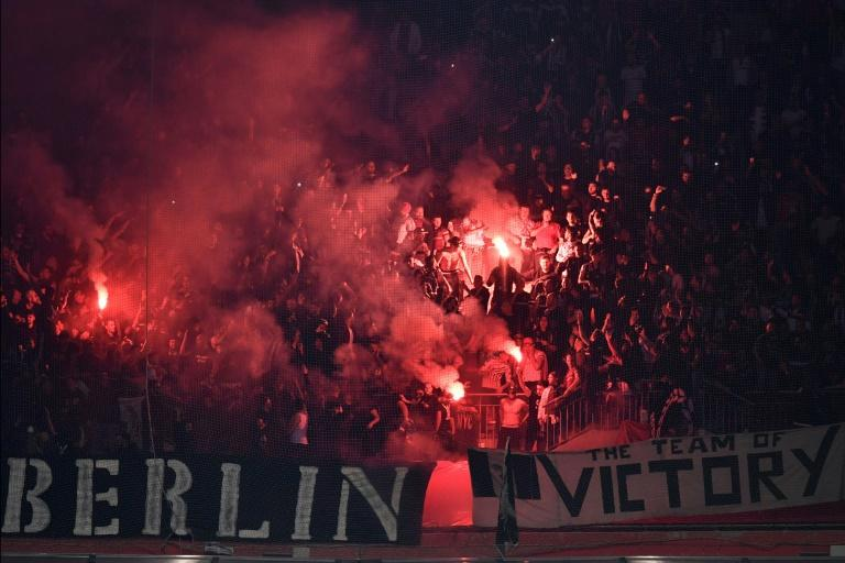 Besiktas supporters burn flares during the UEFA Europa League first leg quarter final football match against Lyon April 13, 2017, at the Parc Olympique Lyonnais stadium in Decines-Charpieu