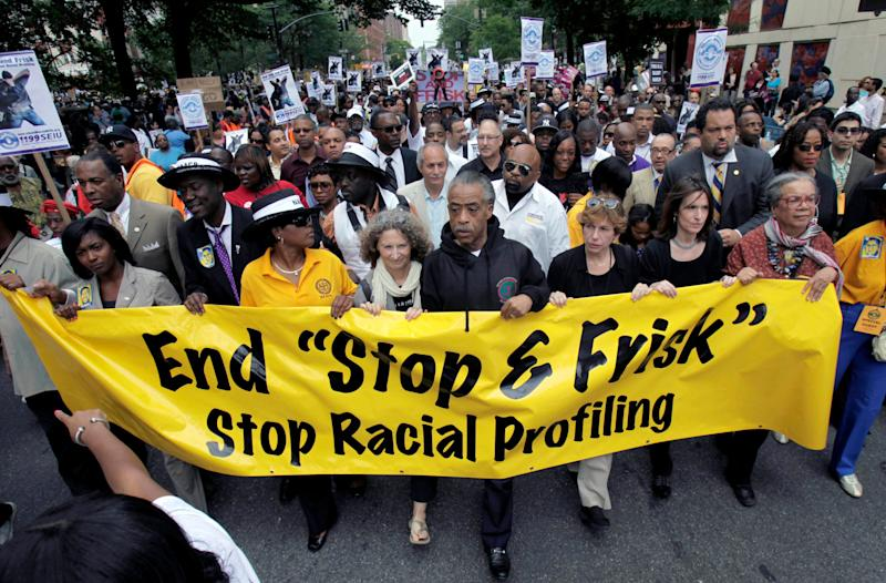 "In this June 17, 2012, file photo, the Rev. Al Sharpton, center, walks with demonstrators during a silent march to end New York's ""stop and frisk"" program. (ASSOCIATED PRESS)"