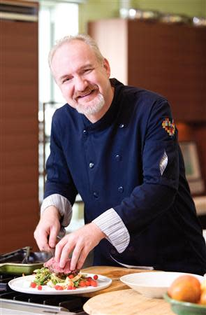 American chef Art Smith cooks at his home kitchen in Chicago