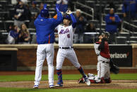 New York Mets' Joey Lucchesi and third baseman Jeff McNeil (6) celebrate after scoring on McNeil's home run against the Arizona Diamondbacks during the third inning of a baseball game Saturday, May 8, 2021, in New York. (AP Photo/Noah K. Murray)