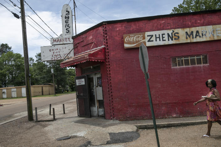 A woman walks by a convenience store in Greenwood, Miss., Tuesday, June 11, 2019. The city has been afflicted by unemployment and drugs. (AP Photo/Wong Maye-E)