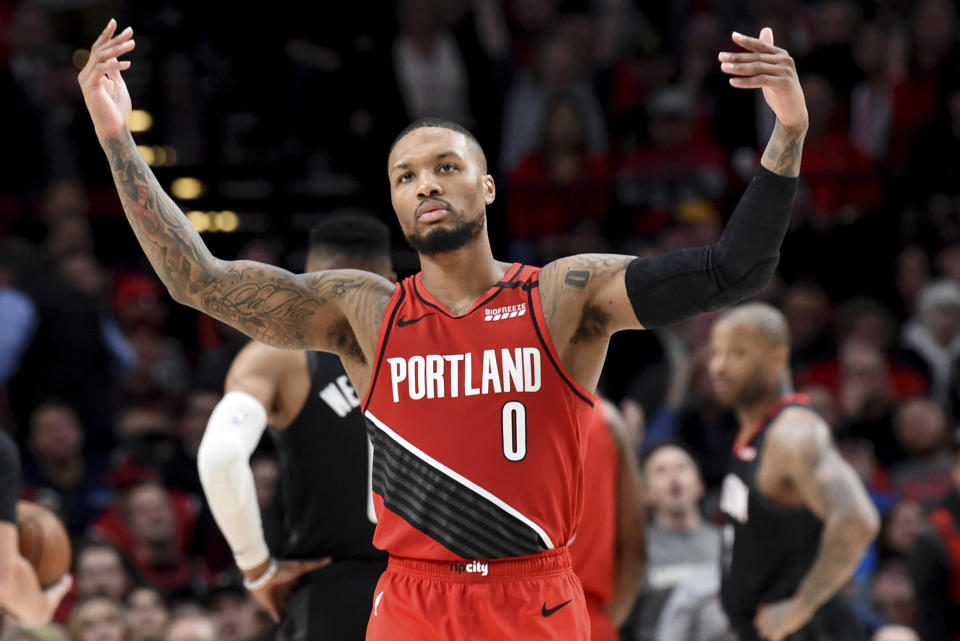 Portland Trail Blazers guard Damian Lillard urges on the crowd after scoring during the second half of the team's NBA basketball game against the Houston Rockets in Portland, Ore., Wednesday, Jan. 29, 2020. The Blazers won 125-112. (AP Photo/Steve Dykes)