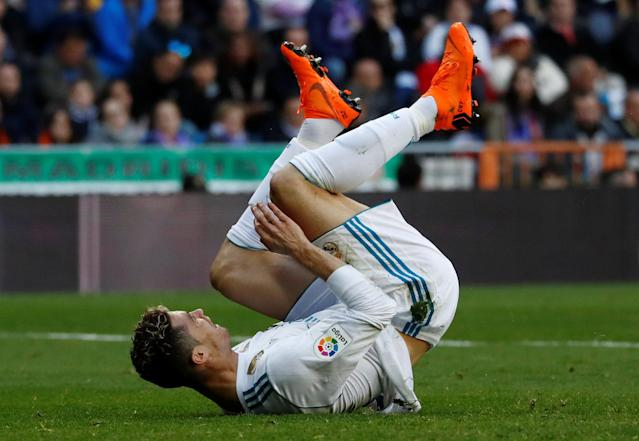 Soccer Football - La Liga Santander - Real Madrid vs Deportivo Alaves - Santiago Bernabeu, Madrid, Spain - February 24, 2018 Real Madrid's Cristiano Ronaldo tumbles REUTERS/Juan Medina