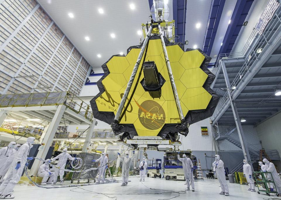 """<span class=""""caption"""">The James Webb Space Telescope is the biggest orbital telescope ever built and is scheduled to be launched into space on Dec. 18, 2021.</span> <span class=""""attribution""""><a class=""""link rapid-noclick-resp"""" href=""""https://www.flickr.com/photos/nasawebbtelescope/33433274343/in/album-72157711864921848/"""" rel=""""nofollow noopener"""" target=""""_blank"""" data-ylk=""""slk:NASA/Desiree Stover"""">NASA/Desiree Stover</a>, <a class=""""link rapid-noclick-resp"""" href=""""http://creativecommons.org/licenses/by/4.0/"""" rel=""""nofollow noopener"""" target=""""_blank"""" data-ylk=""""slk:CC BY"""">CC BY</a></span>"""