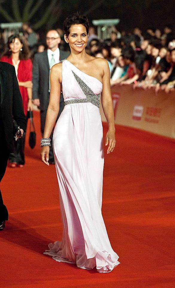 "Halle Berry graced the 12th Annual Shanghai International Film Festival with her gorgeousness in a one-shouldered lilac Marchesa gown, matching bangles, and updated 'do. Andrew Ross/<a href=""http://www.gettyimages.com/"" target=""new"">GettyImages.com</a> - June 13, 2009"