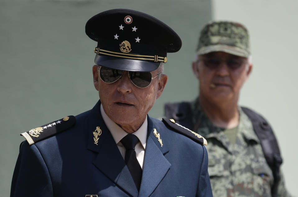 Secretary of Defense Salvador Cienfuegos Zepeda arrives for a review of the troops that will participate in the Independence Day parade, in Mexico City, Wednesday, Sept. 14, 2016. Thousands will gather in Mexico City's main square, known as the Zocalo, on Friday for a massive military parade to commemorate Mexico's independence from Spain.(AP Photo/Rebecca Blackwell)