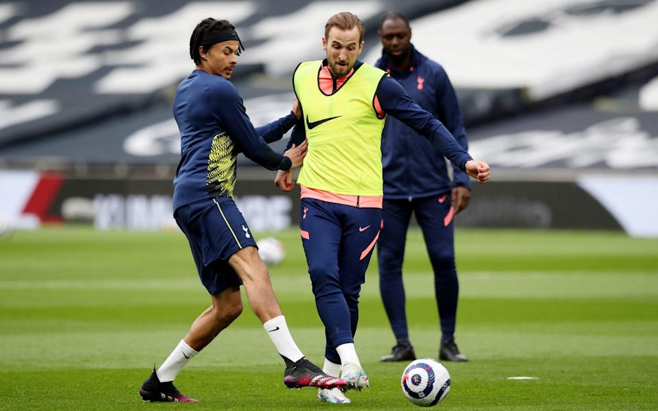 Dele Alli and Harry Kane tussle for the ball in the warm-up - REUTERS