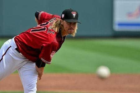 FILE PHOTO: Mar 7, 2019; Salt River Pima-Maricopa, AZ, USA; Arizona Diamondbacks starting pitcher Zack Greinke (21) throws during the second inning against the Cleveland Indians at Salt River Fields at Talking Stick. Mandatory Credit: Matt Kartozian-USA TODAY Sports